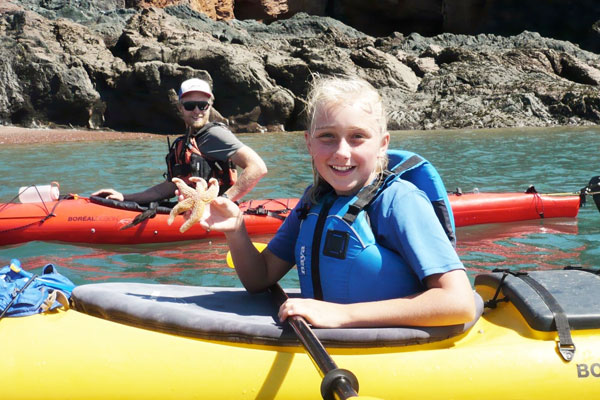 Family kayaking tour at low tide
